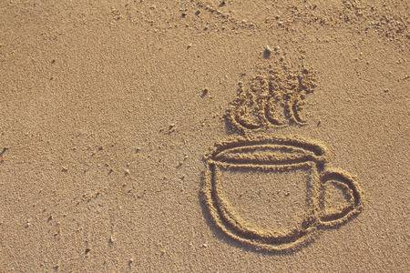 26487899-vintage-coffee-cup-drawn-on-sand-beach-filtered-image